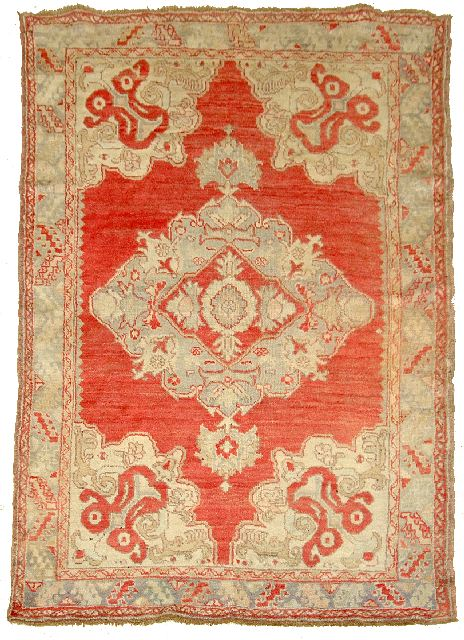 An Antique Turkish Ushak Wool Rug