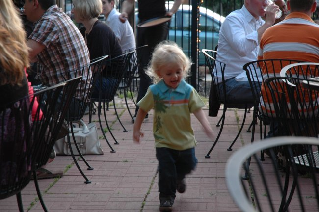 Claes running on patio at Momocho